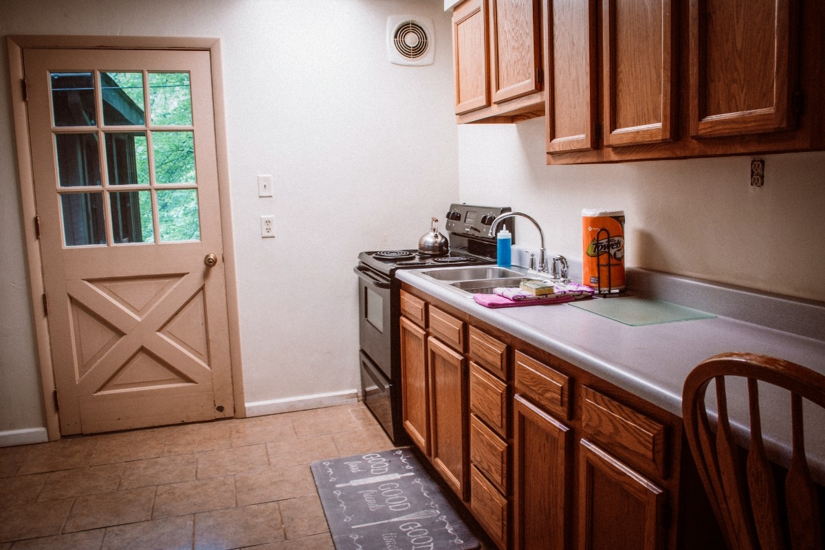 Kitchen in Cape Cod house - Kitchen and side door.