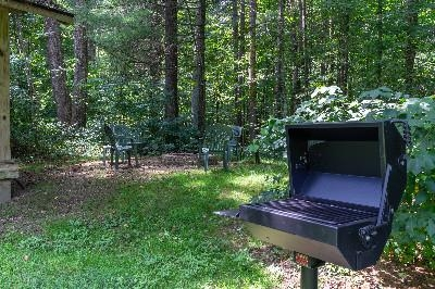 Out back - On the rear of our unit is the fire pit and charcoal grill.