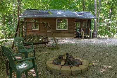 Exterior Picture - We have a firepit with seating at the cabin. You can purchase fire wood from us or bring your own.