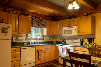 Kitchen - Our kitchen is fully equipped and includes the eat-in table area.