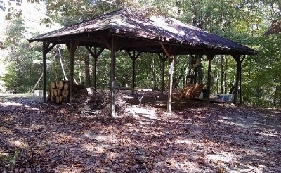 The Pavilion - Fire pit, table, swing, close to composting toilets.  Tent camping available at this site, great for a group of 3 tents. Or use for gathering.