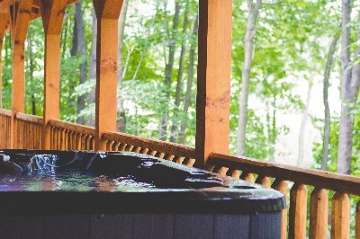 Hot tub - Relax in the hot tub on the back covered deck over looking the wooded lot