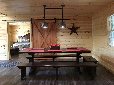 Dining area - Custom table made by Hocking Hills artisan. Seats 12-14