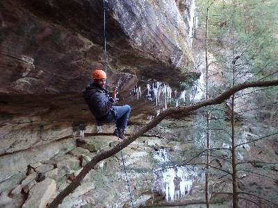 TrekNetwork rappelling big spring falls  - Colin rappelling a 115 foot waterfall