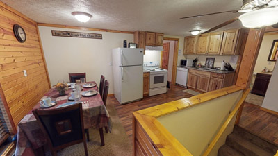 Whitetail Cabin Kitchen  Dining Area - Kitchen comes equipped with all the amenities and appliances you need for a getaway. Just bring food!