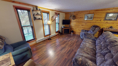 Whitetail Cabin Living Room - Spacious living room for relaxing after exploring Hocking Hills and Wayne National Forest. Equipped with flat screen TV, DVD player, and an electric fireplace.