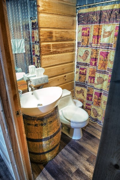 Downstairs Bathroom - Custom made vanity with antique barrel.