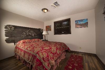 Bedroom 3 - Queen bed with custom head board.