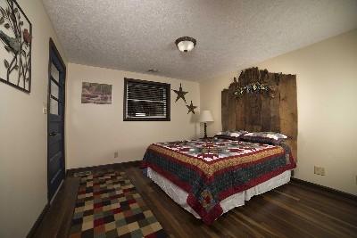 Bedroom 4 - Queen bed with custom head board.