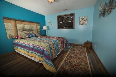 Bedroom 2 - Queen size bed with custom head board.