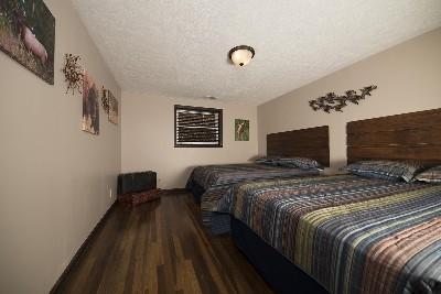 Bedroom 1 - This bedroom features 2 queen beds.
