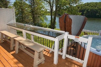 Outdoor Bar area - Enjoy the spacious deck with custom granite bar and 6 person Hot tub.