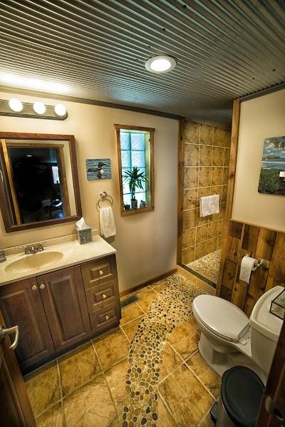 Bathroom - Custom stone path leads to a large walk in shower.