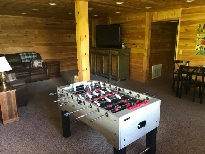 Basement Level Living/Game Area - Foosball and electronic air hockey as well as a separate game table are all found on this level. We share dvds, board games, puzzles, and a variety of books as well as DirecTV.