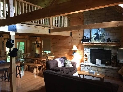 Front Door/Living room into kitchen - The famous black bears welcome you as you enter the lodge.