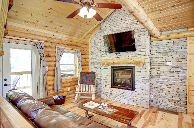 Sweet Retreat Family Room - Family Room with a large flat screen tv and see-through gas fireplace