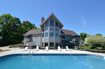 Outside area - Enjoy the large deck area, two propane barbecues, outdoor fire pit, a seasonal pool and two hot tubs.