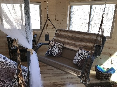 Safari Tree House - Hanging love seat inside