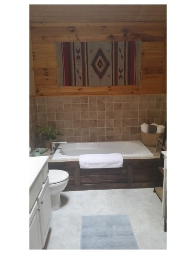 Master Bathroom - Has a one person Jacuzzi bathtub. Spacious with high ceilings and a skylight.