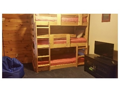 Bunk Bed Room - This room has a 3 tier bunk bed, large closets and bean bag chairs. There is also an Xbox360 with a few games on hand. This TV is not hooked up the the man cable at this time.