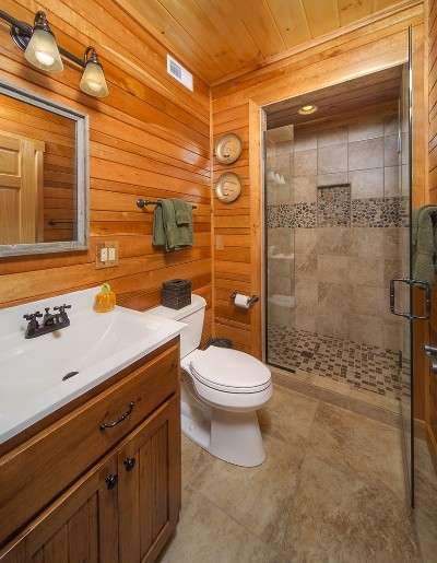 Downstairs bathroom - There is a full bath and shower stall that echoes the stone accents that are on the stoves and kitchen bar.
