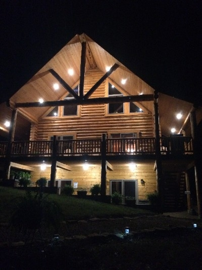 View from the firepit at night. - Over 900 sq. ft. of covered patio are relaxing -- both during the day and at night.