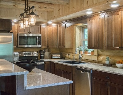 Kitchen - The fully stocked kitchen features custom granite countertops, brand new appliances and a center island with bar that seats 3 guests.  You can even be your own barista with our espresso maker.