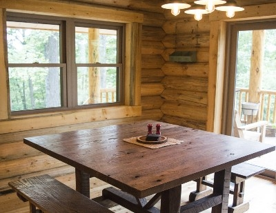 Dining Area - When possible, we have custom ordered all of our furniture from local craftsman.  We support local entrepreneurs and local small businesses as much as we can!  This dining table is a handcrafted gem!