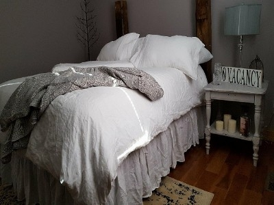 Queen Bed - Snuggle up in these 100 percent linen sheets.