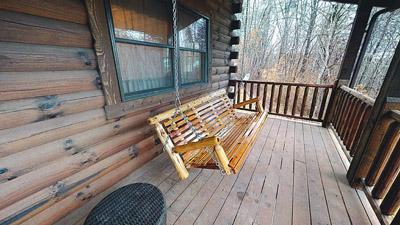 Honeysuckle Ridge Cabin Swing - Enjoy nature from the porch swing