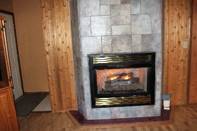 Patriot Cottage Gas Log Fireplace - This fireplace is so cozy and warm.  It is perfect for snowy cold days.