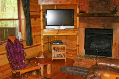 Cozy and Warm - Enjoy the flat screen TV with a large gas log fireplace.