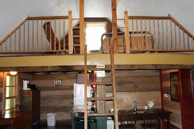 Pioneer loft - This loft is entered by a wooden ladder.  There is a full size bed in this loft.