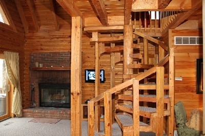 Wood Burning Fireplace - Cozy up by the wood burning fireplace or take the spiral staircase up to your one bedroom loft.
