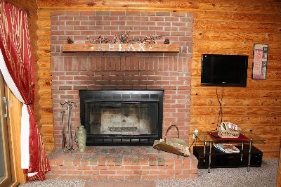 Wood-burning Fireplace - Enjoy the wood-burning fireplace or movies on the TV.