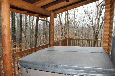 Hot Tub - Enjoy the hot tub on your covered porch.