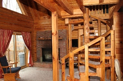 Wood-burning Fireplace - Enjoy the wood-burning fireplace from your loft bedroom or couch.