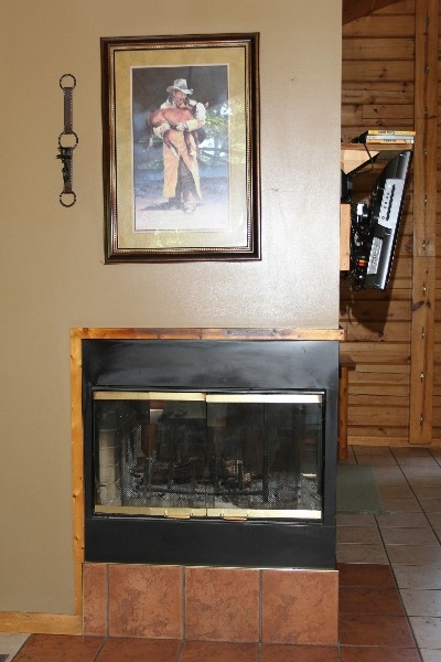 Fireplace - Includes a three-sided wood burning fireplace.