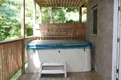 Hot Tub - Hot tub is located under a covered porch.