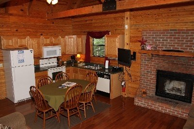 Kitchen  - Includes a fully equipped kitchen, dining and wood burning fireplace.