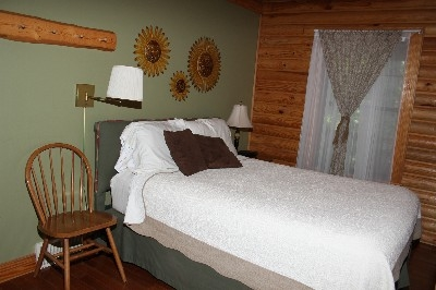 Bedroom - Includes one private bedroom downstairs with Queen bed.