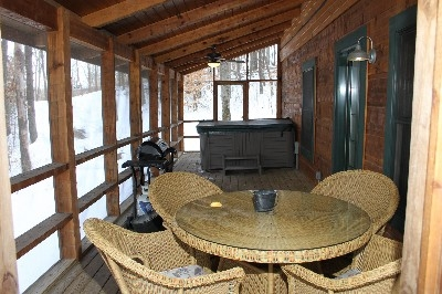 Hot Tub - Hot Tub is located on a covered deck with a screened in porch.