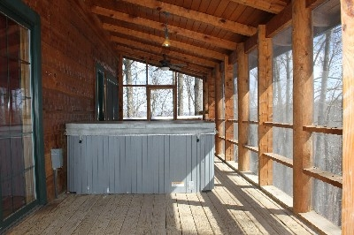 Hot Tub - Hot Tub is located on covered, screened in porch.
