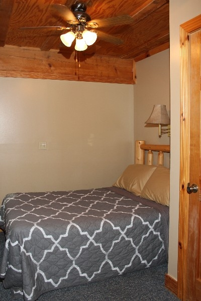 Bedroom  - Private bedroom located on the main level includes a full size bed.