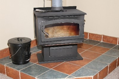 Wood Burning Stove - Located in living room.