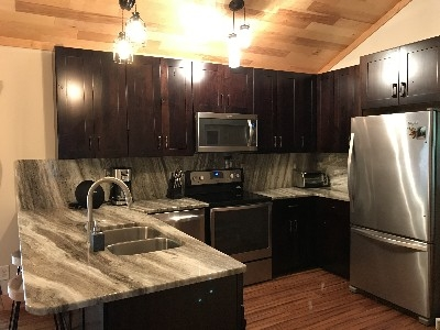 Kitchen - Granite counter and stainless appliances with Hickory Cabinets make this kitchen a dream.