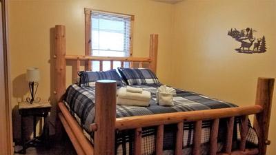 Bedroom - main floor bedroom features log bed