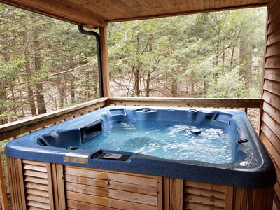 hot tub - the hot tub is located on the raised back deck and is completely secluded.  your view is of the woods surrounding you.