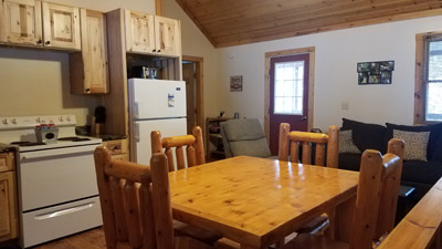 kitchen/dining - log furniture and hickory cabinets highlight the kitchen and dining space