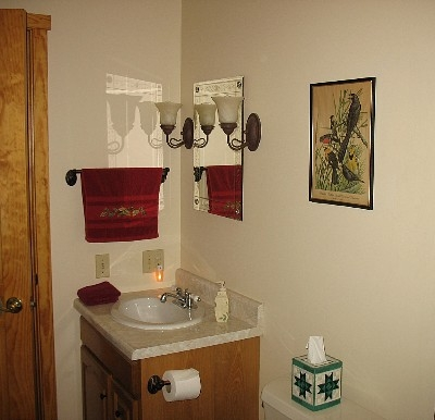 Bathroom  - Vanity with etched mirror and wall sconces